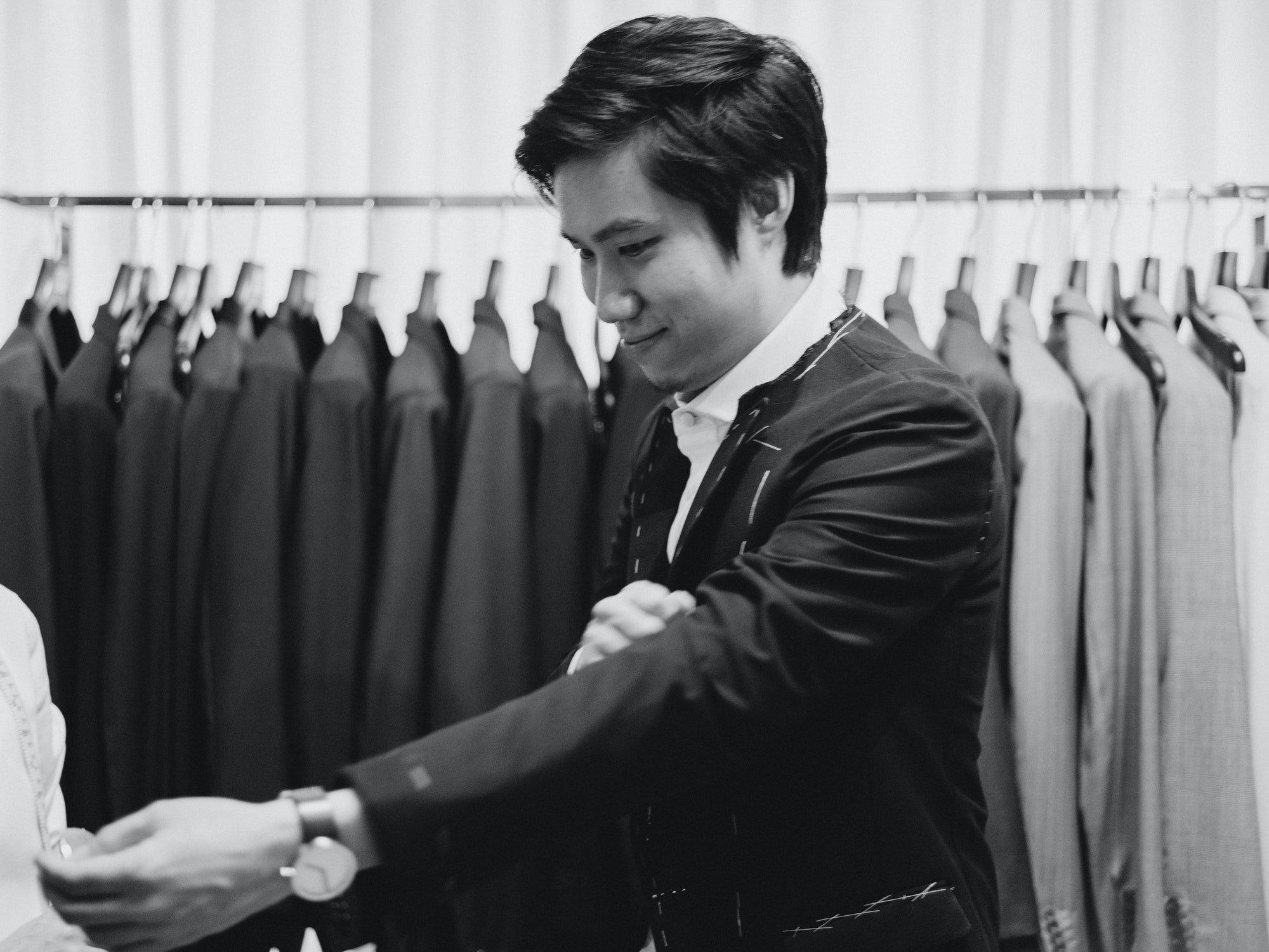 Groom fitting tuxedo