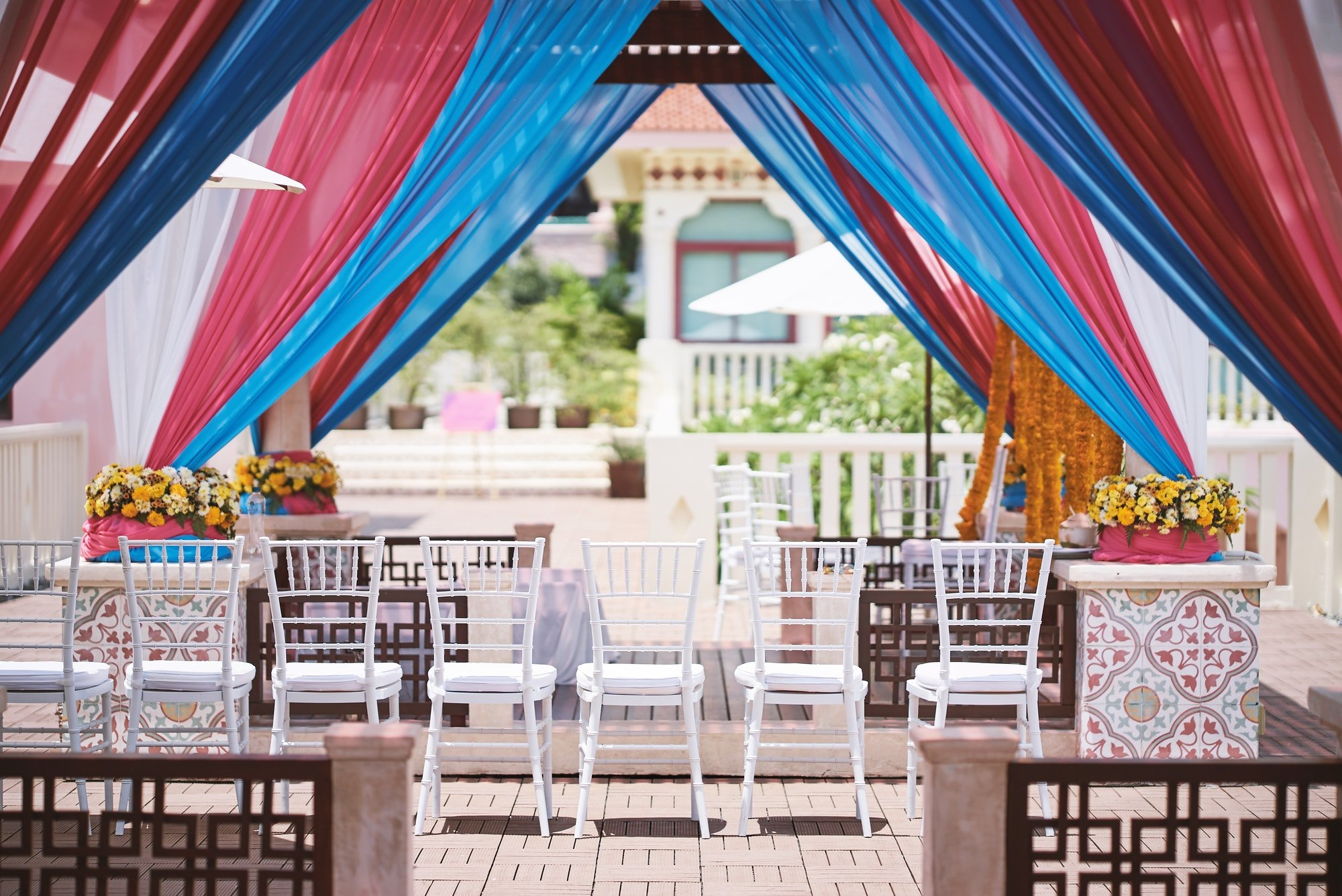 Indian traditional ceremony venue decoration with colorful soft fabric for thread ceremony